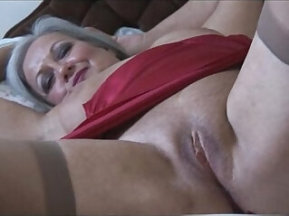 7:20 - Attractive bust granny in slip and stockings strips -