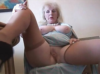 7:02 - Curvy mature british milf lady in stockings strips and poses -