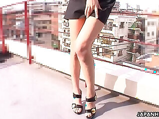 1:38 - Stuffing her pussy with a toy on the rooftop -