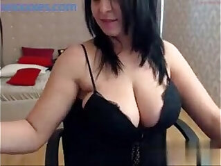 15:49 - Big tits brunette babe shows off her curvy body on cam -